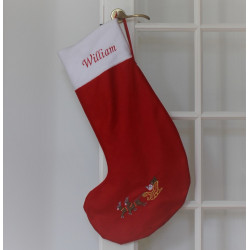 Stor rød julestrømpe med navn og kane på